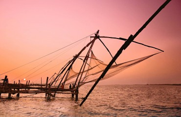 Fishermen and traditional fishing nets Fort Cochin Kerala